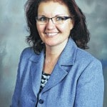 Tolles selects Woods as new district treasurer