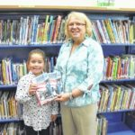 Books donated to school library