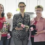 Iota Beta donates blankets for cancer patients