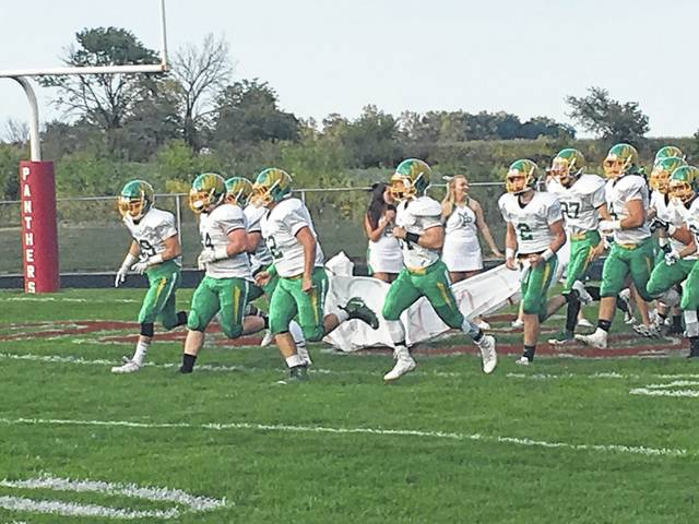 The Madison-Plains football team charged onto the field at Fairbanks Friday. The team came up short on the scoreboard falling 35-20.