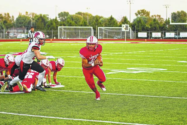 Justin Portman runs the ball after stealing from a Liberty Union player during the first possession of the game Friday. London won the game 28-6.