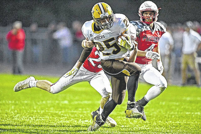 West Jefferson's Wyatt Dillion (25) breaks a tackle on a long run during the Roughriders' 48-27 win at Fairbanks Friday.