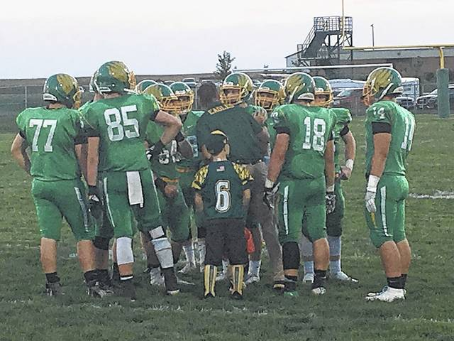 Members of the Madison-Plains offense huddle up during the first quarter of the Eagles game with visiting Mechanicsburg Friday.