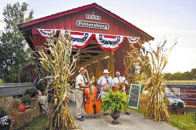 The Pottersburg Bridge, centerpiece of the Covered Bridge Bluegrass Festival, Sept. 23-24. The Muleskinner Band perform at a previous festival.