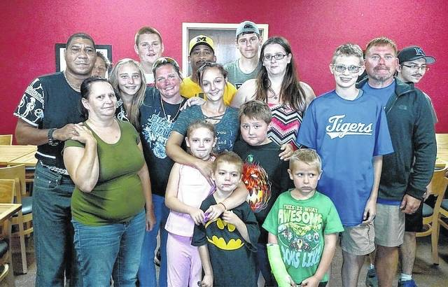 It was a happy reunion when victims of an accident and their heroes got together recently. Some members of the Madison County Tigers Special Olympics Softball Team assisted a family in distress in August.