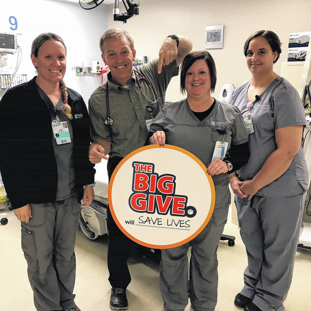 From left are: Erin Beair, RN, Emergency Department Director, Dr. David Duff, Amber Bidwell, RN and Emily Bennington, RN show their support for the Big Give, an online giving event that will benefit services at Madison Health, such as the expansion of the organization's Emergency Department.