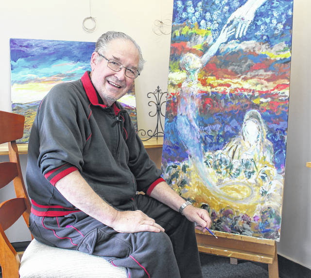 Harry Croghan of London sits with his paintings at the Gallery on High. Croghan will be the featured artist for the gallery for October. His opening will be Friday, Oct. 6 at 5 p.m., and run through Oct. 29.