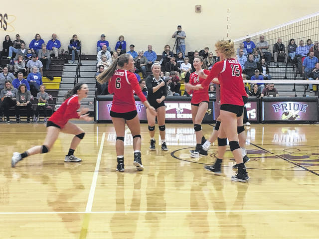 Jonathan Alder players celebrate a point during their D-II district tournament loss to Granville.
