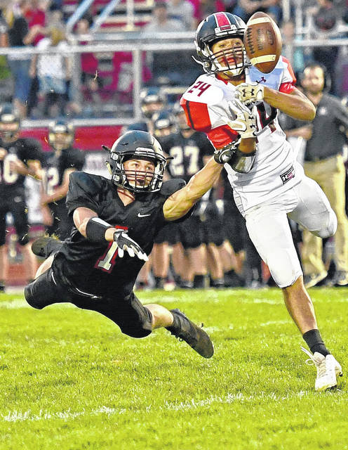 Jonathan Alder's Victor Fenik, left, goes all out for a ball during the Pioneers home game with visiting Bellefontaine Friday night. Jonathan Alder dropped the Central Buckeye Conference tilt 19-6.