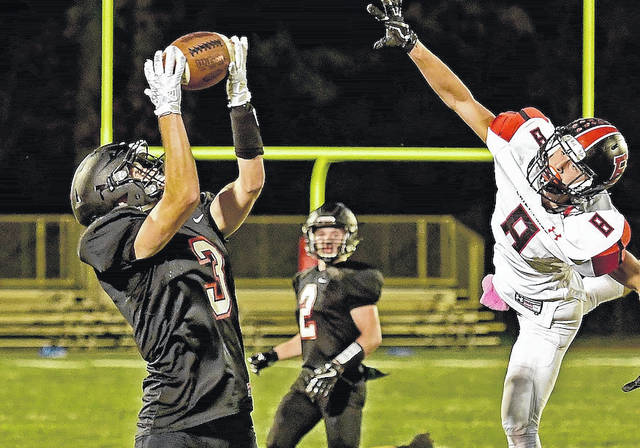 Jonathan Alder's Trevor Mitchell hauls in a pass during the Pioneers 19-6 loss to Bellefontaine Friday night.