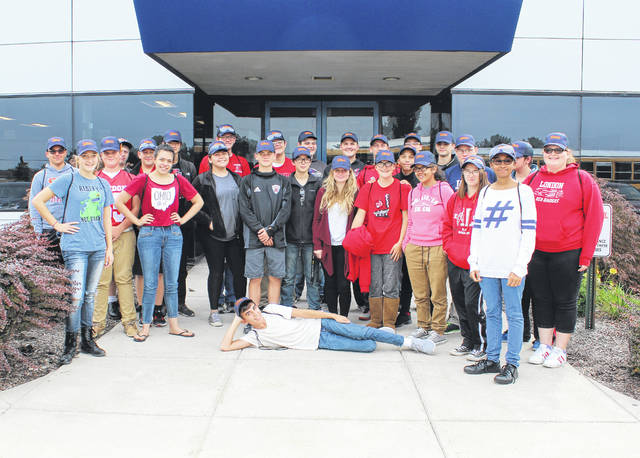 London High School students in front of Stanley Electric on Friday. The students toured the facility as part of October's Manufacturing Month.