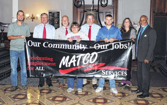Workers from MATCO, a company which offers a variety of vocational and community employment services, were present at the Madison County Commissioners meeting on Monday. They were there to inform the community about Disability Employment Awareness Month for October. From left are: Scott Ringhiser, Productions Manager at MATCO; David Dhume, county commissioner; Mark Forrest, county commissioner; Penny Powers of MATCO; David Hunter, county commissioner; Bobby Higgins, Package Handler at MATCO; Cordelia Comer, Administrative Assistant at MATCO; and Van Viney, CEO at MATCO.