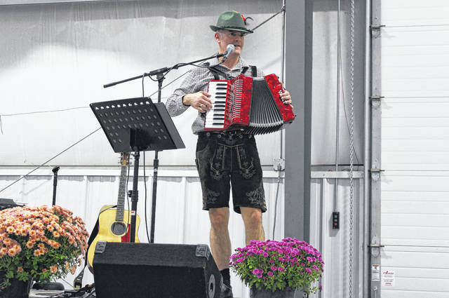 Matt Rees of London performing at the opening of the Republican Central Committee and Women's Club's annual Octoberfest event at the Madison County Fairgrounds on Thursday. Rees wore traditional German lederhosen and performed a variety of festive songs in German to kick off the event.