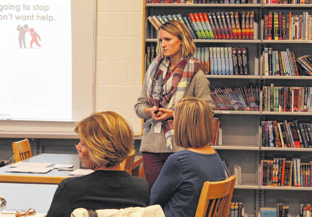 Melanie Luken, a Suicide Support Specialist at Nationwide Children's Hospital, presents Madison County families and school staff with information on the SOS: Signs of Suicide program on Tuesday at Canaan Middle School. The program teaches kids how to detect signs of depression and suicide in themselves or fellow students. Jonathan Alder Schools will implement the program for their sixth, eighth, and 10th grades starting next week.
