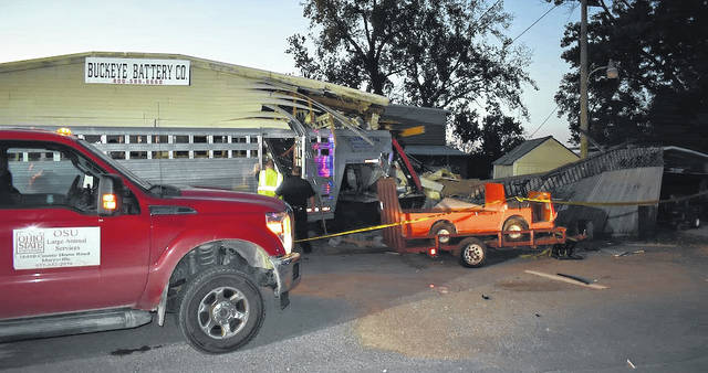 The 2012 Dodge Ram was pulling a cattle trailer and the truck and trailer crashed into a business known as Buckeye Battery at 11219 U.S. Route 42.