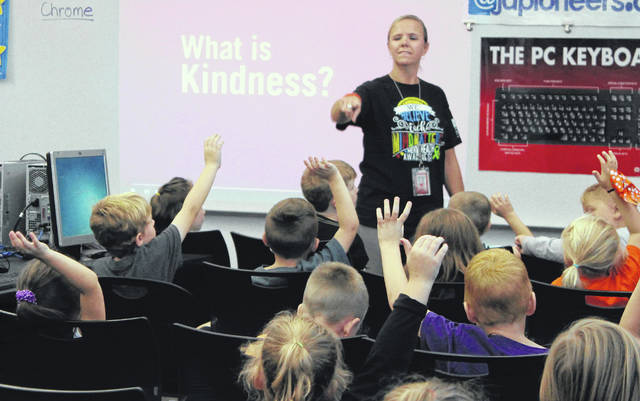 JoLynn Wheatley, the Student Social Worker at Plain City Elementary School, tells students about the Stick Together Program which teaches kids to stand against bullying. The presentation was during the school's Kindness Day on Thursday.