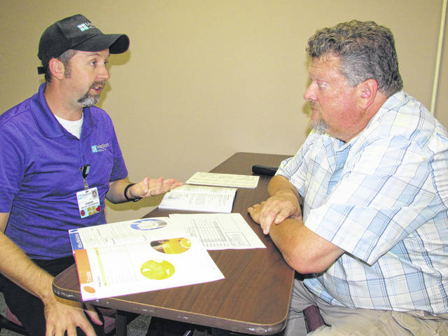 County Commissioner David Hunter, at right, reviews material for his four-session Madison Health Diabetes Program with Darren Renz, director of the Madison Health Food and Nutrition Program.