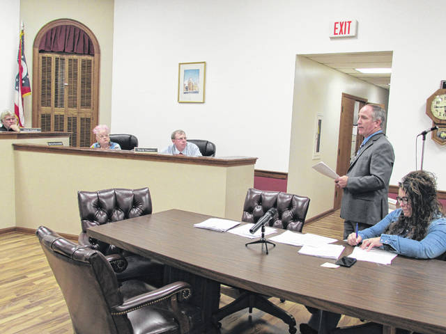 Madison-Plains School District Superintendent Tim Dettwiller, standing, addressed the Mount Sterling Village Council Monday night with an update on how the district is doing in terms of finances and the recently released state report card.