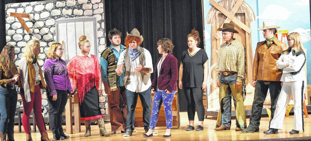 """In London High School's """"Barbecuing Hamlet,"""" seasoned director Margo Daley (played by Ruth Peart) tries to rally her dysfunctional — but lovable — group of actors. From left are: Sarah Meyers, Ciara Cooney, Sara Madden, Lily Marriott, Clay Hurley, Christian Held, Ruth Peart, Sarah George, Hobbes Treynor, Seth Gillilan, Zoey Marshall. London High School will present a new twist on this Shakespearian classic Thursday, Friday and Saturday at 7 p.m. in the school's Joyce Hildebrand Auditorium. Tickets are $6 and will be available at the door. The show is directed by Scott Blanton."""