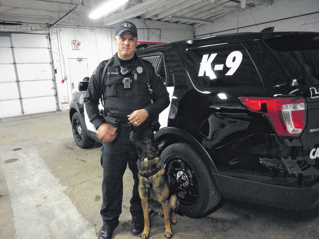 """London Police Officer Mike Combs and """"Ygor,"""" a Belgian Malinois, make up the department's new K-9 unit. Belgian Malinois and German Shepherds are the breeds most trainable for police work, said Chief Glenn Nicol."""