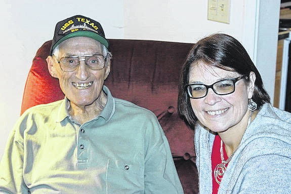 Herb Markley, 94, and granddaughter Kristin Sollars, 48, smile as he reminisces about his time enlisted with the U.S. Navy during World War II.