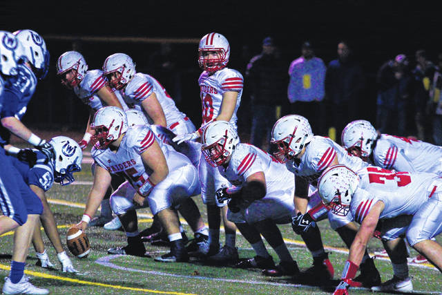 The London offense gets ready to run a play during the Red Raiders OHSAA state playoff game at Cincinnati Wyoming Friday. The Red Raiders lost the game 10-7.