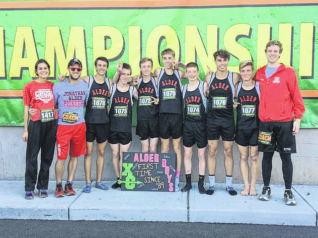 Members of the Jonathan Alder boys cross country team pose for a photo following the Pioneers 12th-place finish at the OHSAA state championship meet Saturday at National Trail Raceway in Hebron.