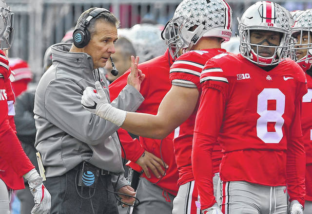 Ohio State coach Urban Meyer talks with players during the Buckeyes lopsided win over Michigan State Saturday.