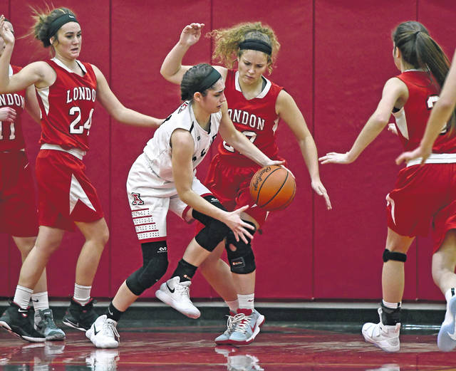 Jonathan Alder's Sydney Bourquin, center, steals the ball from London's Emily Minner during the Red Raiders win over the host Pioneers during the Madison County Thanksgiving Tip-Off Classic Saturday.