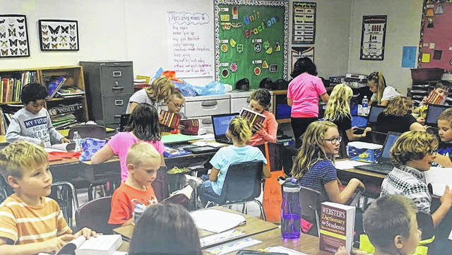 Third graders at Madison-Plains Elementary School using their newly donated dictionaries in October. Every year the Mt. Sterling Masonic Lodge No. 269 donates nearly 100 dictionaries to the school.