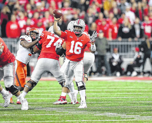 Buckeye quarterback J.T. Barrett, shown here passing against Illinois Saturday, will try to become the first Ohio State quarterback to go 4-0 against Michigan.