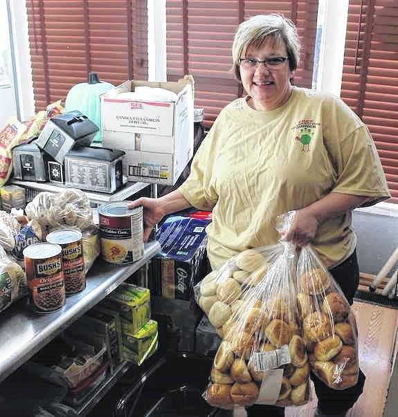 Angie Roberts Harris inventories some of the donated food she and her crew of kitchen workers will be preparing as part of Phat Daddy's Pizza's sixth annual Free Thanksgiving Dinner in London. Customers have the option of delivery, dine-in, or carryout. The dinner is first come, first serve and lasts until the food is gone. Dine-in and carryout start at noon.