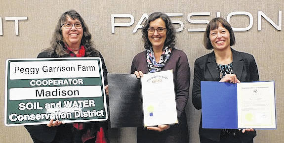 Peggy Garrison, who owns a farm near Mount Sterling, was recognized as Madison Soil and Water Conservation District (SWCD) Cooperator of the Year with a complimentary cooperator homestead sign. She also received proclamations from Congressman Steve Stivers and Senator Bob Hackett for her contribution to agricultural conservation. From left are: Peggy Garrison, Ramona Porter, SWCD Supervisor and Julia Cumming, SWCD program administrator.