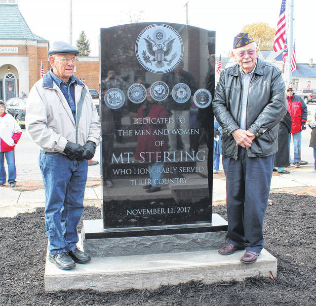 World War II veteran, Tom Whiteside, left, and Korean War veteran, Darrell Cooper stand next to the Mount Sterling veterans monument, dedicated to the village on Saturday.