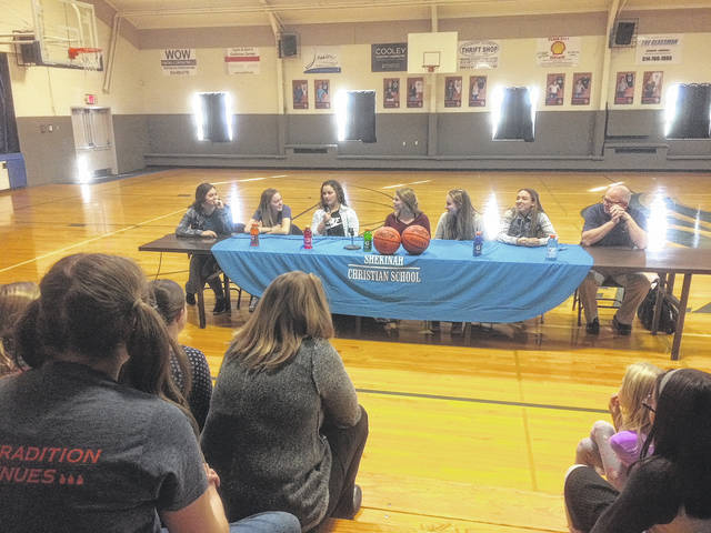 Members of the Shekinah Christian girls basketball team answers a series of questions from school mates during an event on Friday, Nov. 17.