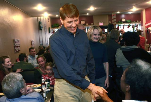 "Former director of the Consumer Financial Protection Bureau Richard Cordray shakes hands after announcing he is a Democratic candidate for Ohio governor Tuesday, Dec. 5, at ""Lilly's Kitchen Table"" Restaurant in Grove City. Cordray chose his hometown of Grove City for his announcement."