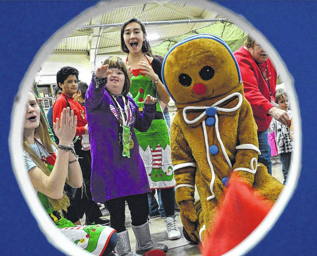 Judging by the expressions of those around her, Madison County's Sophie Brand received rave reviews during a bean bag toss game when she visited Columbus' Beightler Armory recently. The military facility annually hosts a fun-filled day for Madison County children with disabilities.
