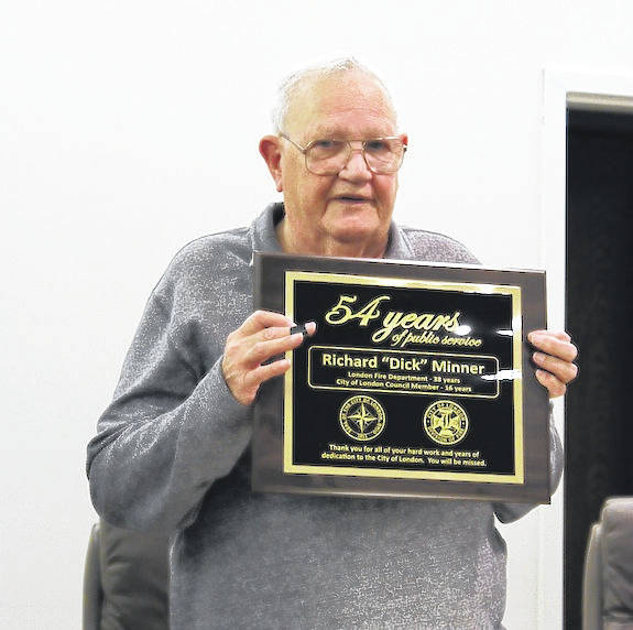 Dick Minner received a plaque of recognition of service for his 54 years to the community from Mayor Patrick Closser. Thursday was his last meeting as a member of council.