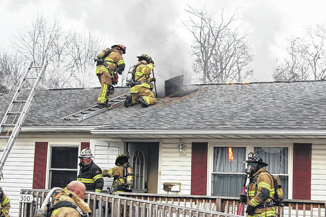 The London Fire Department works to put out a fire at 300 McLene Ave. Monday evening. The house, owned by Madison Community Housing, serves as a group home to individuals with developmental disabilities. All three of the women living there were evacuated with the help their staff person, Nicole Sweet, of Champaign Residential Services Inc. Details as to cause of the fire were not available at presstime.