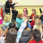 Local author delights students with 'Gingerbread Man'