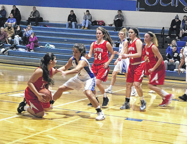 London's Kaitlin Patterson, left, goes to the floor to get a loose ball while Bishop Ready's Dani Hall plays defense and a host of Red Raiders look on. London won the game 41-39 Wednesday.