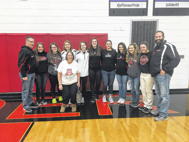 Members of the 2017 Jonathan Alder High School softball team were on hand for the unveiling of the team's state final four banner. The unveiling took place during halftime of the Pioneers girls basketball game with Bellefontaine Wednesday, Dec. 20. Coach Dave McGrew, far left, led his team to a 22-5 record last spring and made the program's second state semifinal appearance (2014).