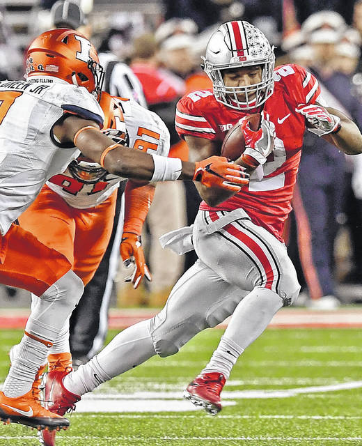 Ohio State's J.K. Dobbins runs for yardage during the Buckeyes win over Illinois earlier this season. The OSU athletic department is one of the most profitable programs in the country.