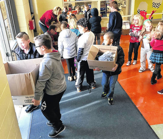Students at London Elementary School helping in the food drive are a mixture of students in Khara Cunningham's second grade class and Chad Reeser's fifth grade class.