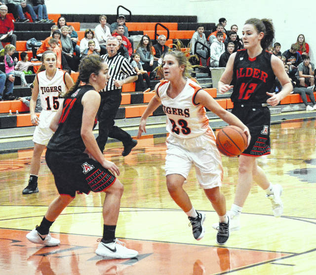 West Liberty-Salem's Taylor Lauck (23) races past her defender and cuts into the lane against Jonathan Alder on Thursday during the West Liberty-Salem win over the Pioneers.