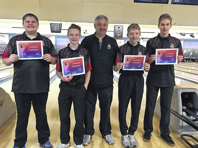 Members of the Jonathan Alder bowling team pose with their All-Tournament Team certificates following the Red and Blue Classic. They are from left: tournament runner-pp Luke Honigford, Josh DeVore, Coach Rusty Walter, Jackson Lane and Andrew Clark.