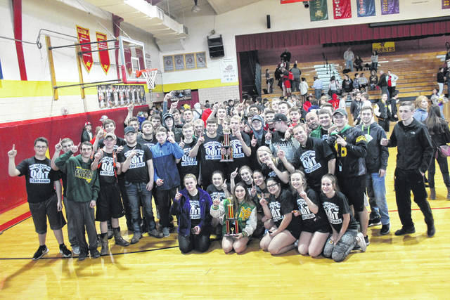 Members of the Madison-Plains Power Lifting team pose for a photo after both the boys and girls teams each won championships in the Eric Wheeler Invitational held at Springfield Northeastern Saturday.