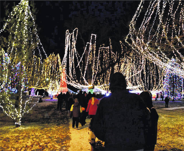 Crowd files into Christmas in the Park in West Jefferson Saturday night following the parade to enjoy the cavalcade of lights.