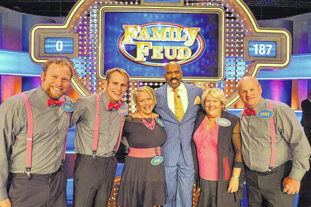 Andrew Beckman, a resident of Choctaw Lake, stands with his family and host, Steve Harvey, at a taping of the game show <em>Family Feud.</em> Beckman&#8217;s episode will air Tuesday, Jan. 30 at 7 p.m. on the CW Network. The Beckman family from left are: Ben Beckman, Andrew Beckman, Becki Bahnson, Steve Harvey, LoRae Beckman and Steve Beckman.