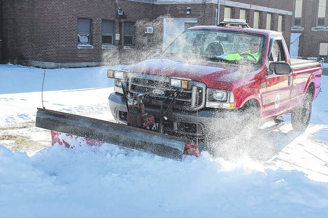 London's Street Department superintendent, Bill Long, plows the lots around the city's community center for easier access for Tuesday evening's youth basketball practice. Despite temperatures dipping below zero, the city's road crews can be counted on to be out for snow removal. Main priorities are the state routes, followed by highly traveled connector roads, and then residential areas. The city asks that citizens be patient during a snow event.